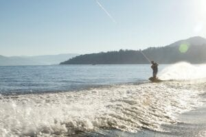 wakeboarder on Okanagan lake enjoying the outdoor summer activities in Kelowna