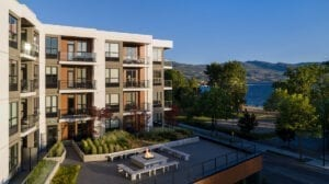 The Shore Kelowna on Okanagan lake, with an outdoor terrace and fireplace for guests to enjoy, shown here on a sunny day in the Okanagan